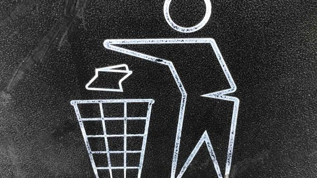 Chalk drawing of figure throwing rubbish in a bin