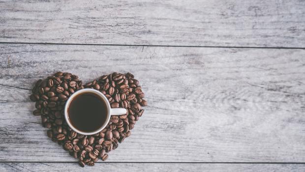 coffee mug in coffee beans